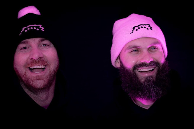 Two young men in woolly hats.