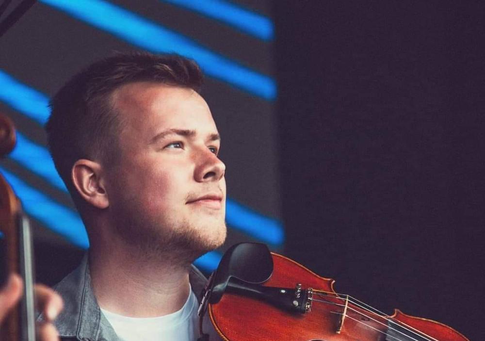 Young man playing violin.