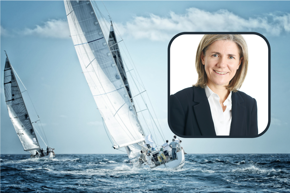 Picture of competitive sailing with woman in business suit in inset.