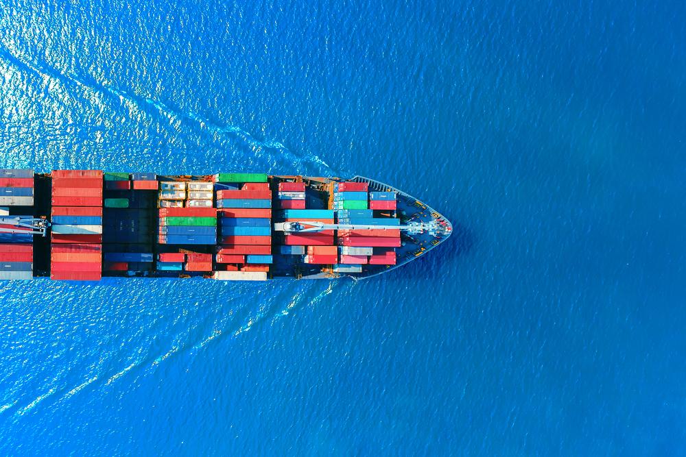 Ocean freighter crossing a blue sea.