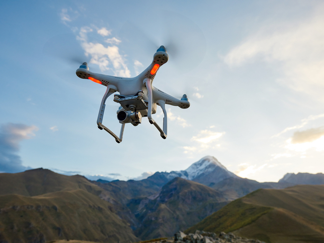 Drone flying over a mountain.