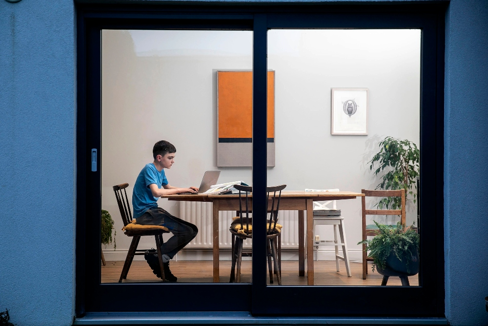 Young boy studying at home.