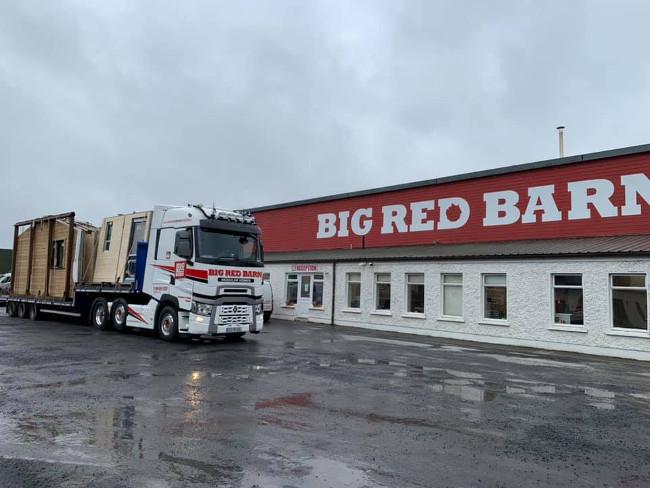 Truck outside Big Red Barn headquarters.