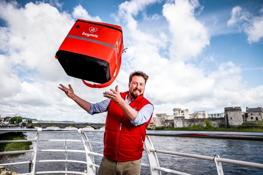 Man in red gillet jacket beside River Shannon, Limerick.