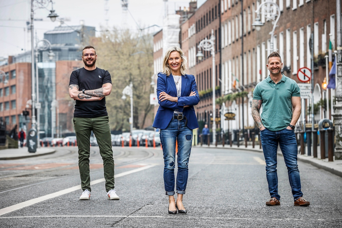 Two men and a woman on a Dublin street.