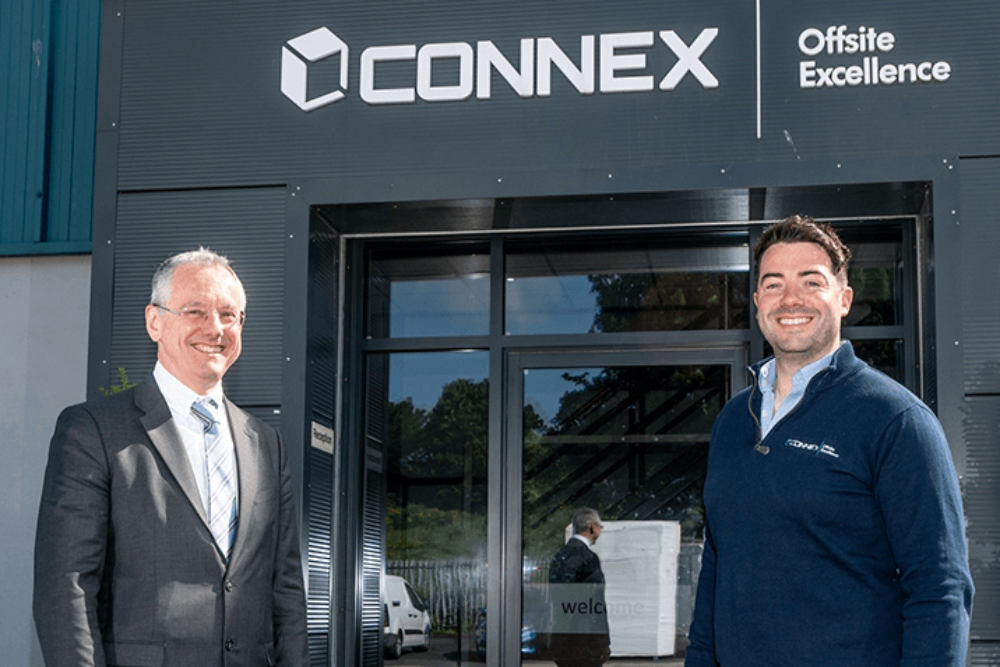 Two men standing outside Connex building in Newry.
