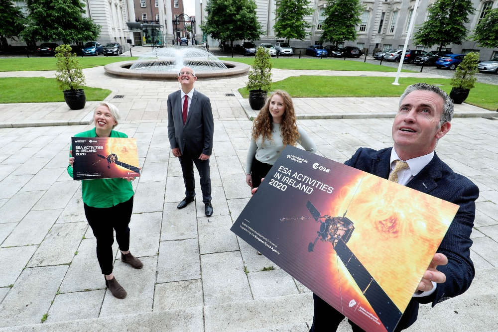 Two women and two men standing at Government buildings in Dublin to promote Irish space industry.