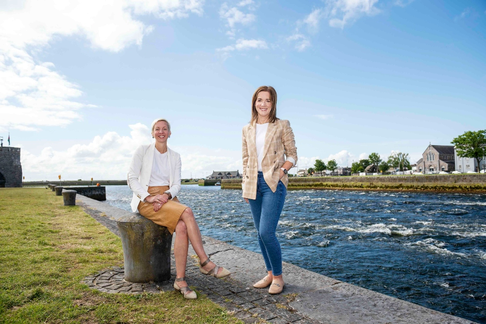 Two women standing in Galway Bay.