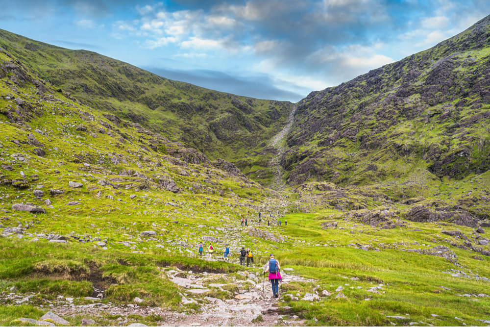 Group of hikers in Cronins Yard starting to climb Devils Ladder to reach the highest mountain in Ireland Carrauntoohil, Ring of Kerry, Ireland.