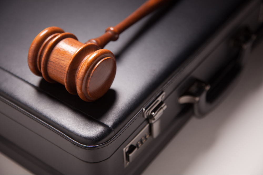 Gavel and Black Briefcase.