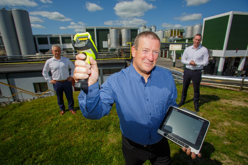 Three men with 5G equipment at a Glanbia cheese plant.