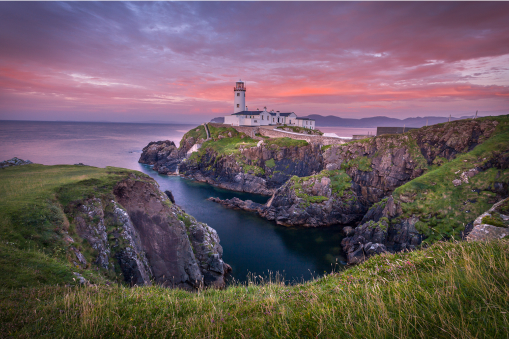 Fanad head at Donegal, Ireland with lighthouse at sunset.