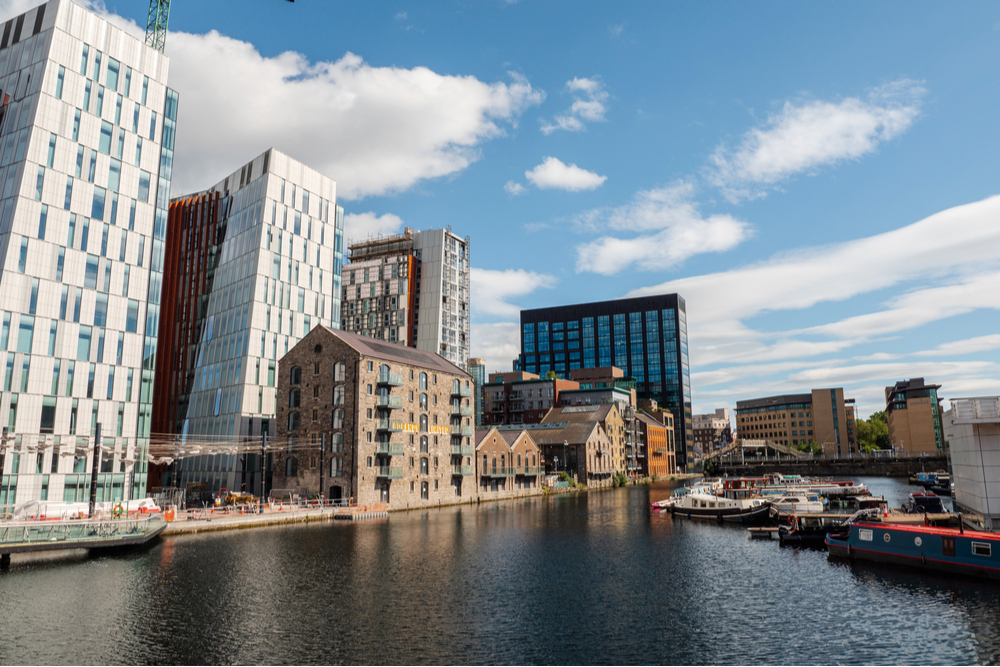 Dublin Docklands modern urban area with high property and rental value, warm sunny day.