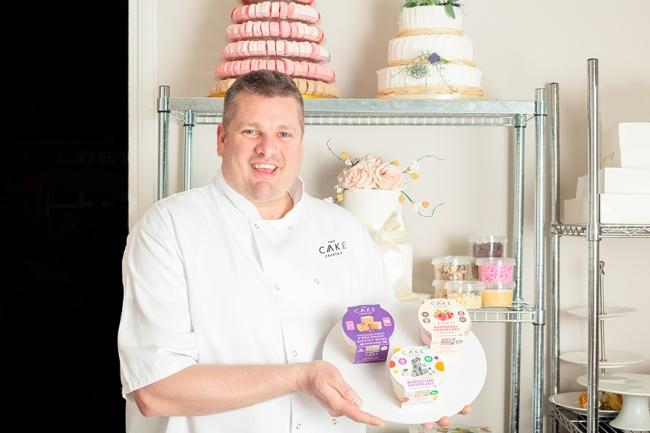 Man holding a cake.