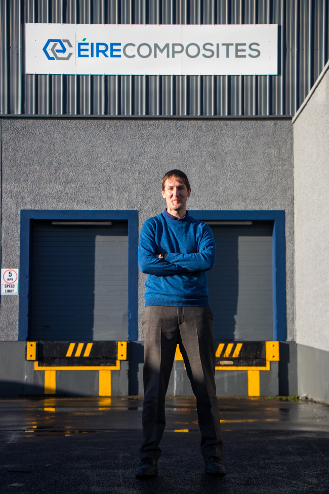 Man standing in front of an industrial unit.