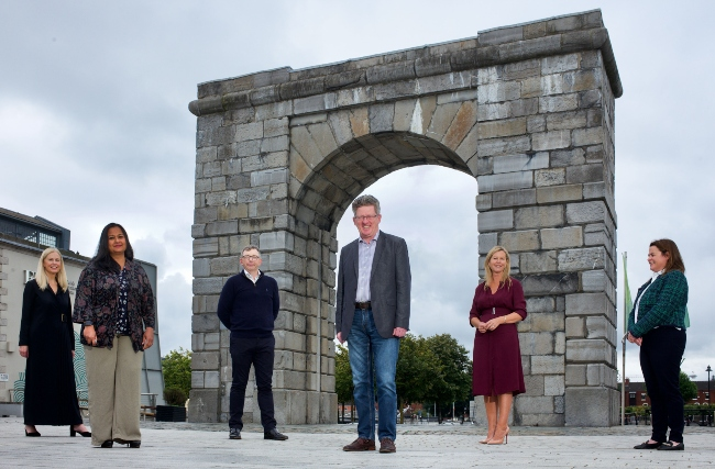 Group of people standing under an arch in Dublin.