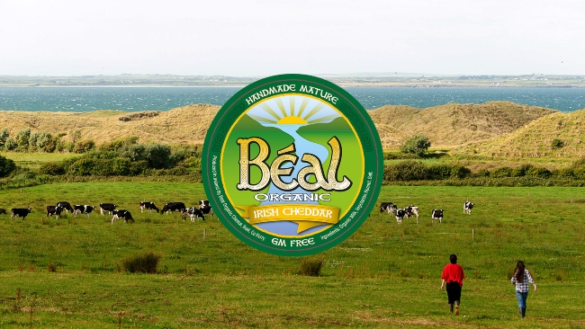 Logo for Beal Organic Cheese on a rural background.