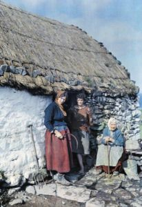 Three generations of Irish women outside their cottage. Ireland in the 1920s.
