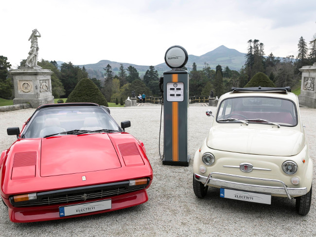 Two classic cars, a Ferrari and a Fiat, converted into electrical vehicles.