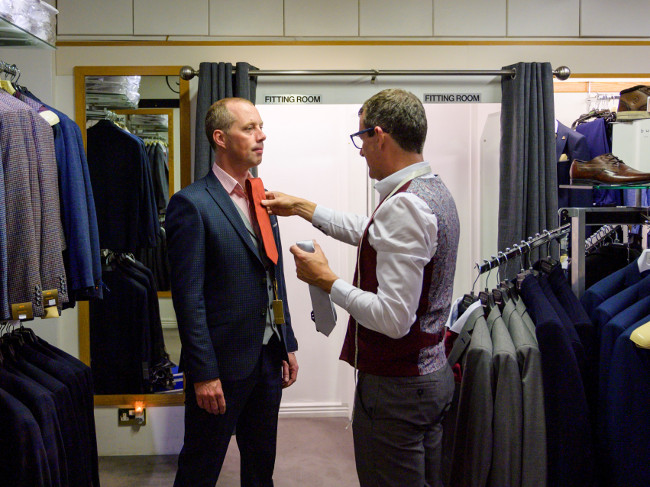 Man getting fitted for a suit.
