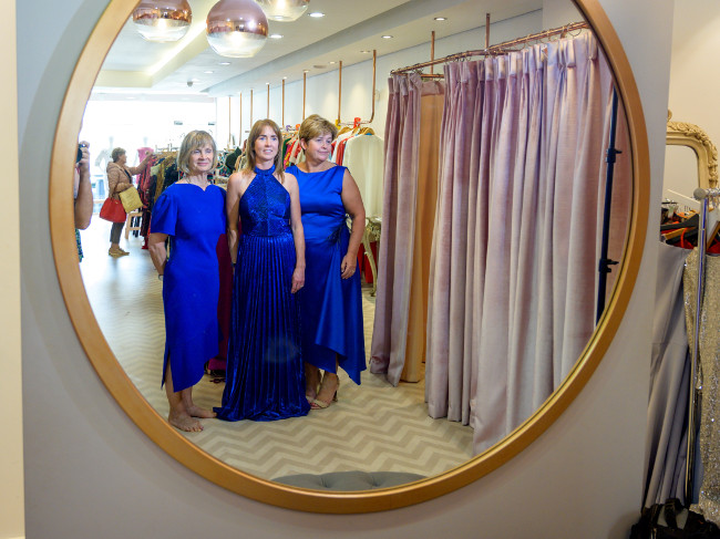 Group of women in blue dresses.