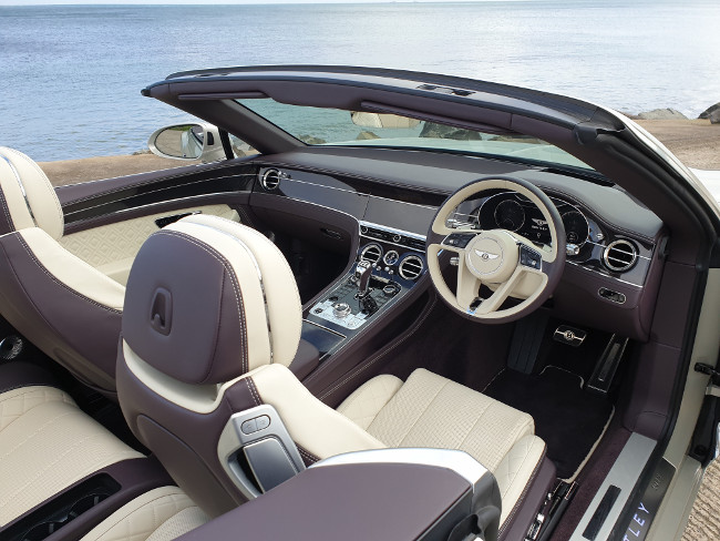 Front seat of a luxury Bentley convertible car.
