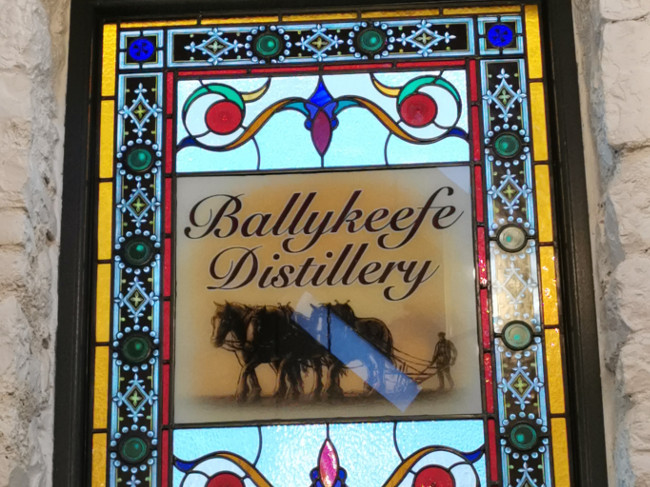The stained glass window in a converted barn turned visitor centre depicting Morgan Ging's grandfather ploughing with three horses.