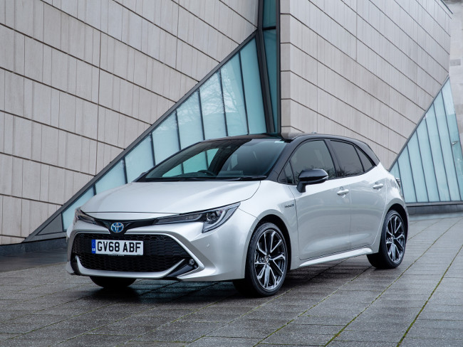 Picture of a silver Toyota hybrid Corolla.