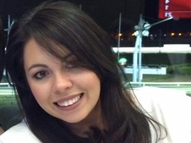 Smiling woman with dark hair.