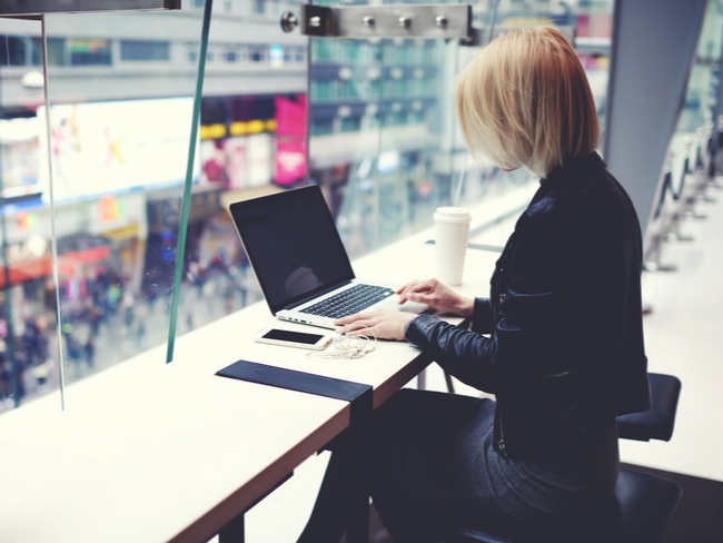 Young woman at a remote working bench.